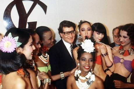 YSL surrounded by his diverse group of fabulous model-muses.
