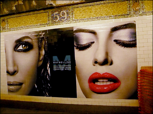 A Maybelline poster in the subway