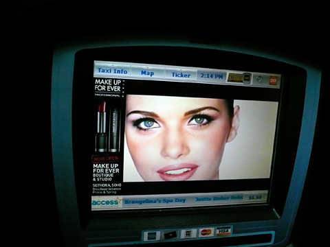 Makeup ad on taxi TV
